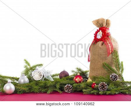 Christmas background with jute sack, cones on white.