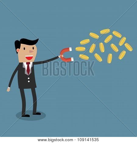 businessman with magnet and Gold coinor