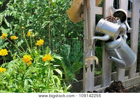 Watering Cans In Garden