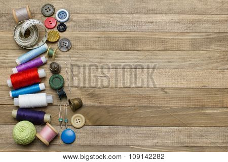 Sewing Kit On Left Side Wooden Backgrounds