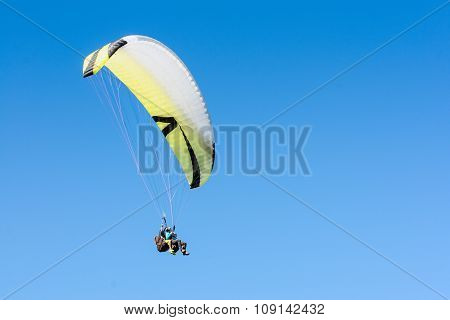 Paragliding Sport Flight On Soaring Wing In Clear Blue Sky
