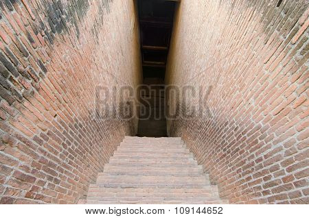 Mystery walkway passage with brick wall on both sides