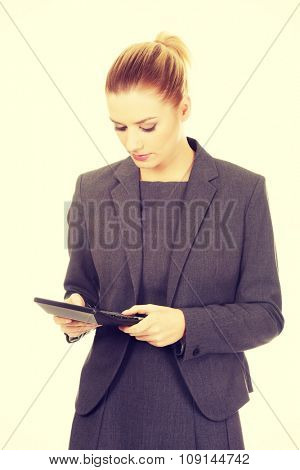 Beautiful business woman with a calculator.