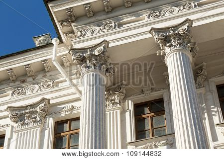 Columns on blue sky background.