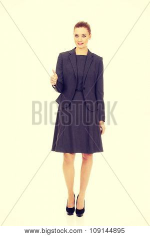Beautiful business woman showing thumbs up.
