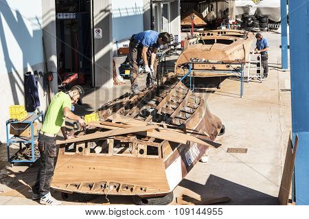 Artisans At Work In The Construction Of Boats