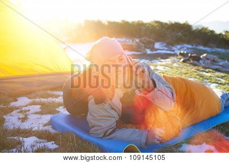 Girl Lying In A Sleeping Bag.