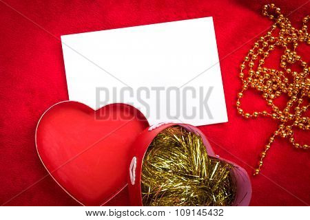 heart with a blank card on red background.