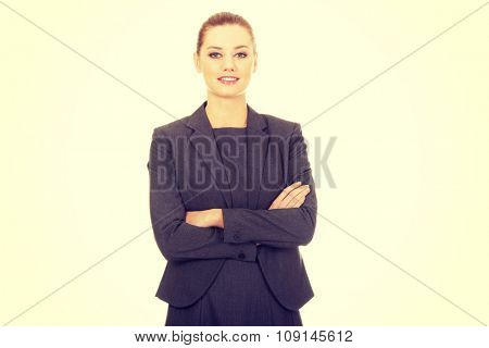 Happy smiling businesswoman with crossed arms.
