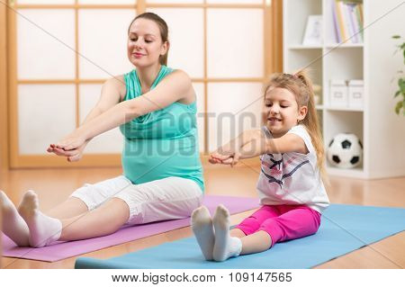 Pregnant woman with her first child doing gymnastics