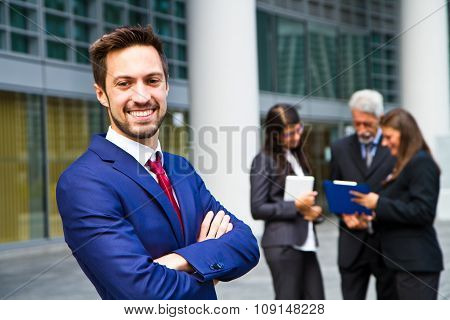 Beautiful Man On The Background Of Business People