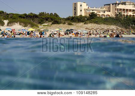 Campulongu Beach, Italy - August 28: Campulongu Beach In Villasimius Crowed Seen From The Blue Sea W