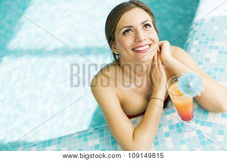 Beautiful Woman In A Pool With A Cocktail