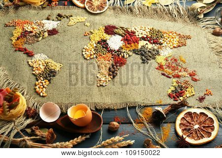 Spices on sackcloth on wooden background