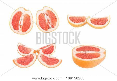 Slices Grapefruit cut in half, isolated on a white background