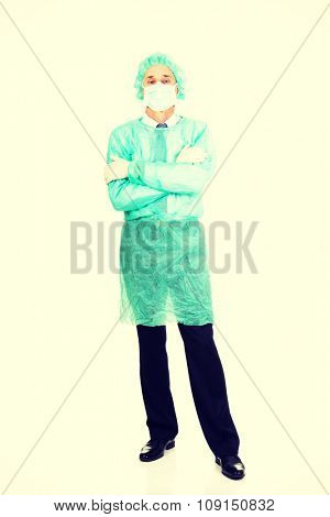 Mature male doctor with protective clothes.