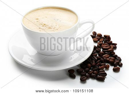 A cup of tasty drink and scattered coffee grains, isolated on white