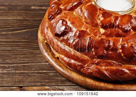 Russian Wedding Round Loaf Close-up On Wooden Table. Wedding Bread With Salt. Russian Wedding Ceremo