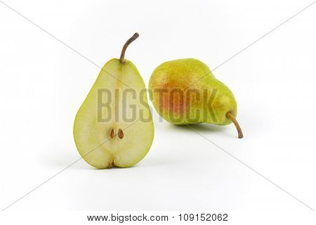 one and half ripe pears on white background