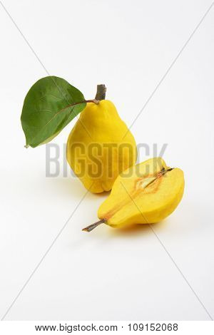 one and half yellow pears on white background