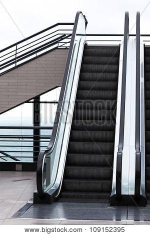 modern escalator on a white background