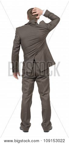 Thoughtful businessman on white, rear view