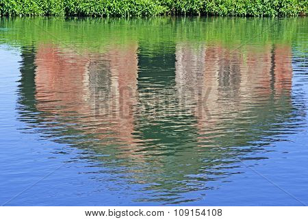 Farmhouse Reflected In The Water