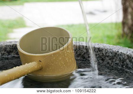 Japanese stone water basin with bamboo ladle