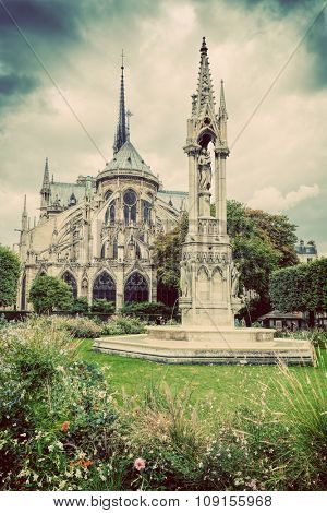 Notre Dame Cathedral in Paris, France. View from Square Jean XXIII. Vintage