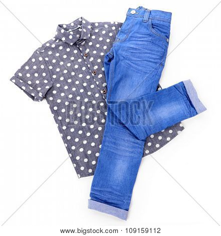 Blue jeans with shirt in peas isolated on white background
