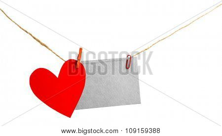 Paper heart and empty sheet hang on cord isolated on white background