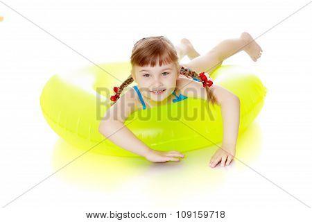 Girl swims in a circle