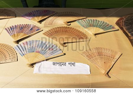 Handicrafts Made Of Wood , Japanese Fans, Are Being Sold At Pingla Village, India