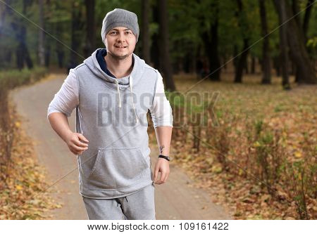 Jogging Young Man At The Park