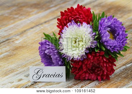 Gracias (thank you in Spanish) with colorful bouquet of aster flowers