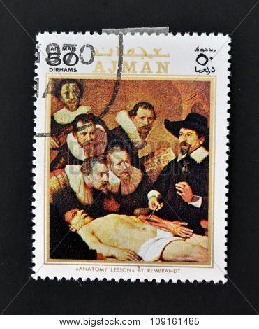 AJMAN - CIRCA 1970: A stamp printed in Ajman shows Anatomy lesson by Rembrandt circa 1970