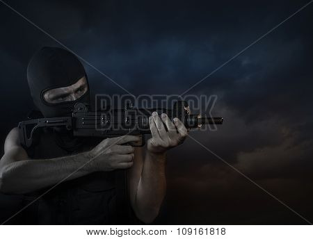 Balaclava and terrorist with machine gun on Cloud Background