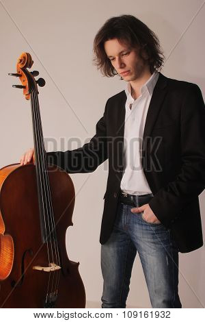 portrait of the young beautiful stylish musician