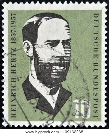 GERMANY - CIRCA 1957: a stamp printed in Germany shows Heinrich Hertz Electric Flux Lines Discovery