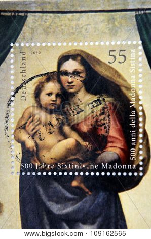 GERMANY - CIRCA 2012: A stamp printed in Germany shows Sistine Madonna Painting by Raphael