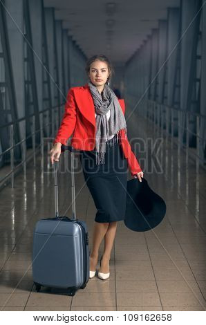 Girl Is On The Move With A Suitcase