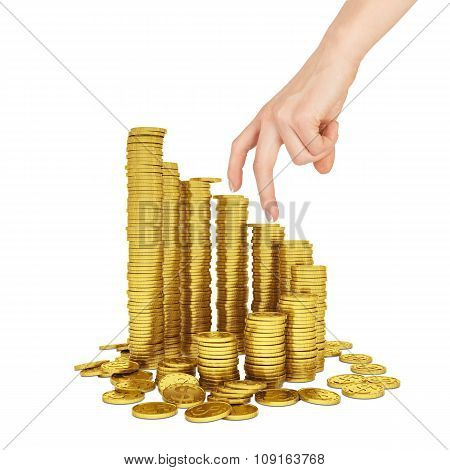 Womans hand with gold coins on white