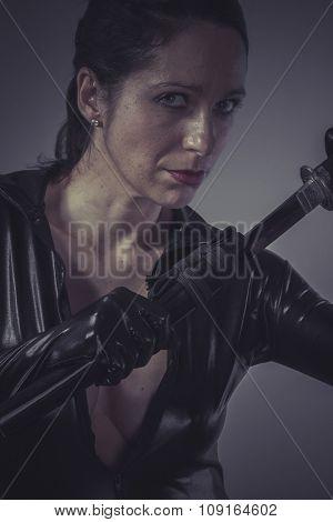 brunette woman wearing black latex, Japanese katana