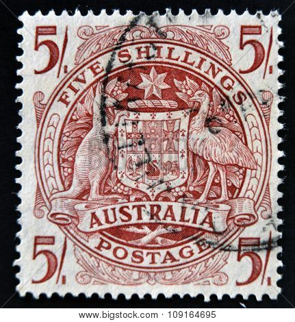AUSTRALIA - CIRCA 1949: A stamp printed in Australia shows the Arms of Australia five shillings