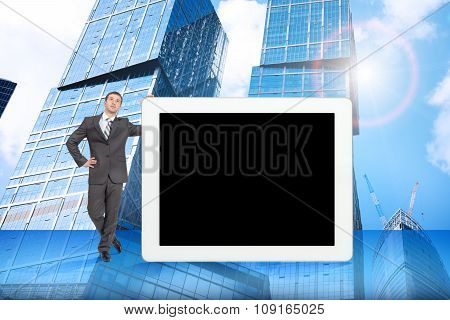 Businessman and big tablet with blank screen