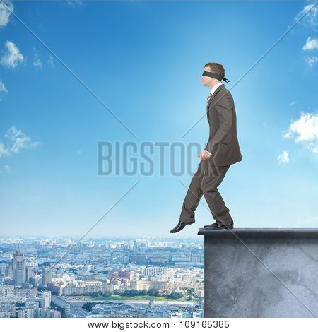 Man walking from edge of building roof