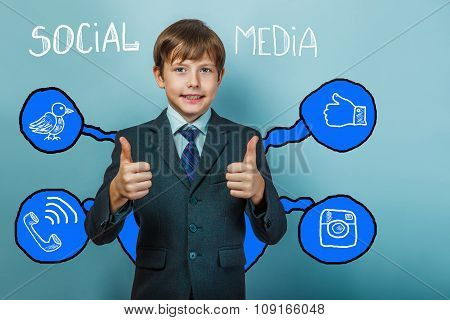 Teen boy businessman shows hand sign yes and smiles social media
