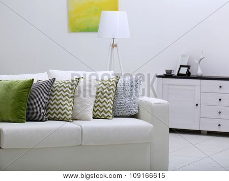 Sofa with colorful pillows in room