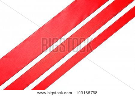 three red diagonal ribbons, isolated on white