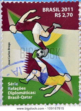 stamp printed in Brazil dedicated to diplomatic relations between Brazil and Qatar shows football